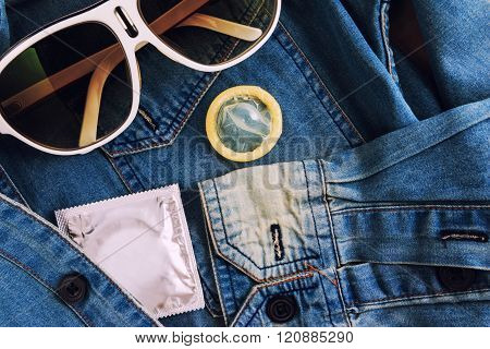 Condom In The Vintage Blue Jeans Pocket. Focus On The Condom.