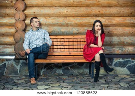 Young couple sitting apart on the bench