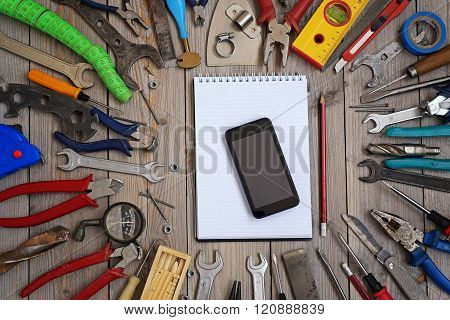 Set Of Tools On A Wooden Floor, Top View.