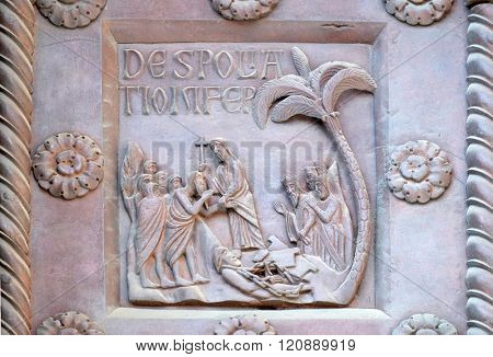 PISA, ITALY - JUNE 06, 2015: Detail of the San Ranieri gate of the Cathedral St. Mary of the Assumption in Pisa, Italy on June 06, 2015