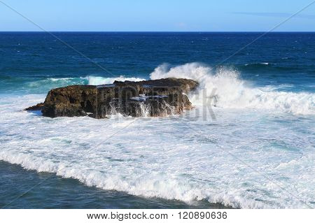 Amazing view to Gris-Gris sea cliffs on Mauritius Island where the constant squashing of waves against the flanks of the cliff gives the impression that the cliff is crying.