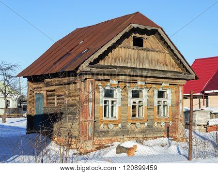 Old Small Abandoned Wooden House In Winter