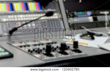 Blurred close up equalizer controller tv and sound on stage