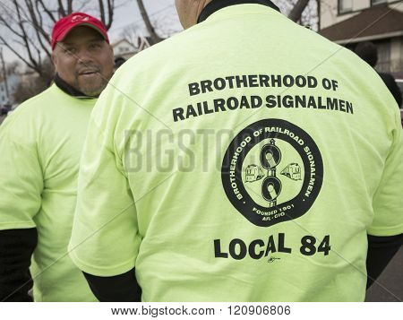 MAR 5, 2016 - WOODBRIDGE, NJ: NJ Transit rail workers wearing Brotherhood of Railroad Signalmen, Local 84 tshirts show support of the rail labor unions at the rally a week before the strike deadline.