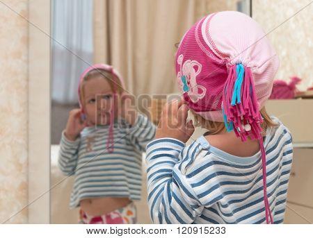 Cute Baby Looking Into Mirror