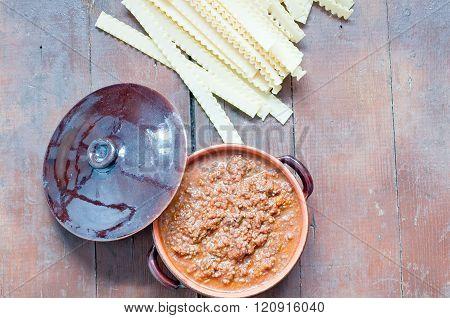 ragu bolognese in a clay pot,italy