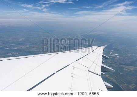 Airplane Wing Over rural area