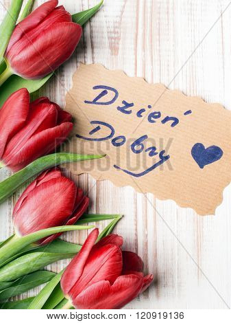 Polish words Good morning and bouquet of tulips