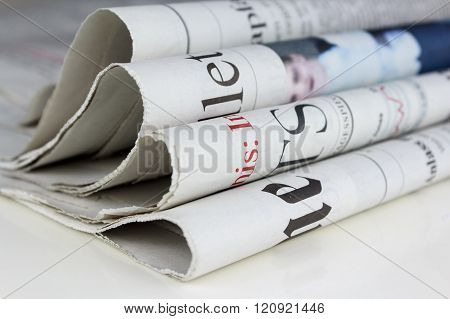 Newspapers on table