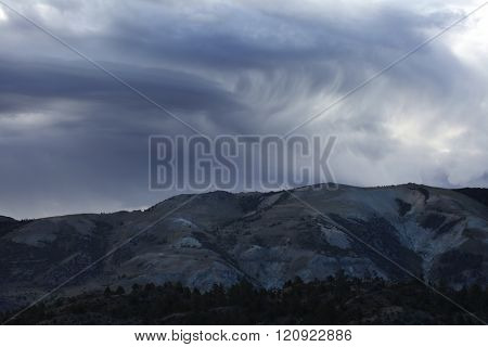 Exotic Storm Clouds Over the Mountains