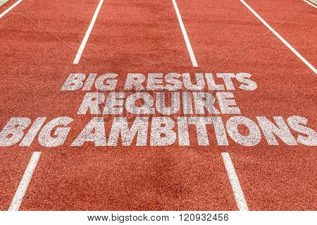 Big Results Require Big Ambitions written on running track