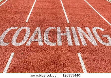 Coaching written on running track