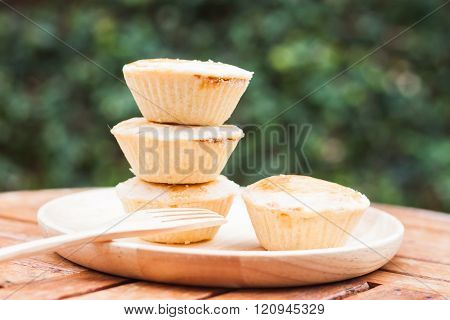 Mini pies on wooden plate
