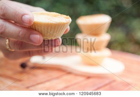 Woman's Hand Holding Mini Pies