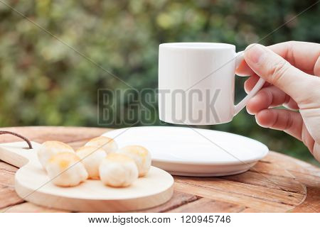 Woman's hand holding coffee cup