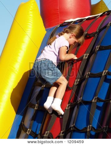 Little Girl On Inflatable Carnival Bouncy