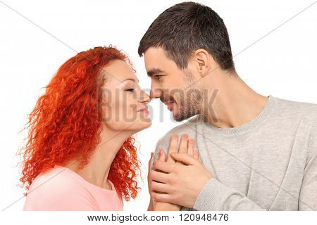 Happy young couple in love looking at each other, isolated on white