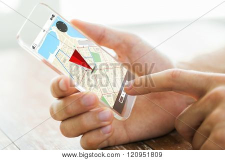 navigation, location, technology and people concept - close up of male hand holding transparent smartphone with gps navigator map on screen poster