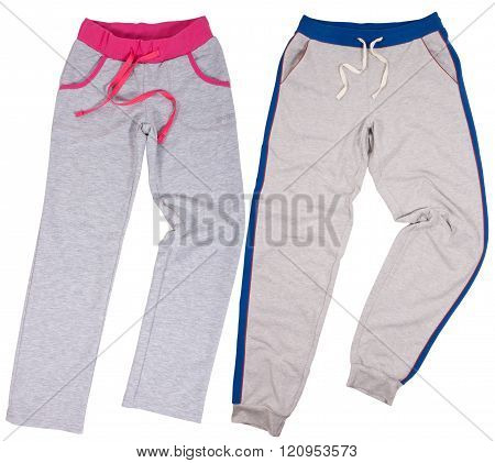 Set of male and female sweatpants. Isolated on white background.