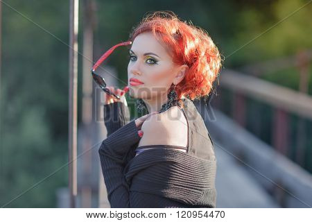Young woman at the bridge