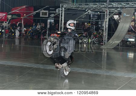 Stuntman riding a scooter during stunt show