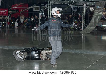 Stuntman with a scooter during stunt show