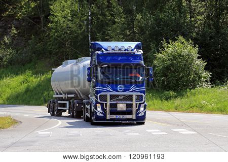Blue Volvo FH Tank Truck At Road Intersection