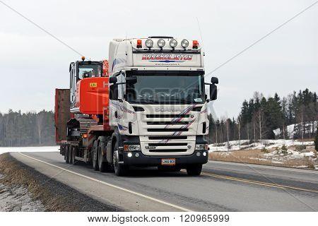 White Scania Truck Hauls Hitachi Zaxis Medium Excavator