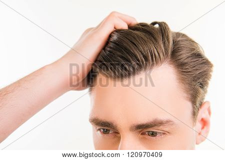 Close Up Photo Of Healthy Man Combing His Hair With Fingers
