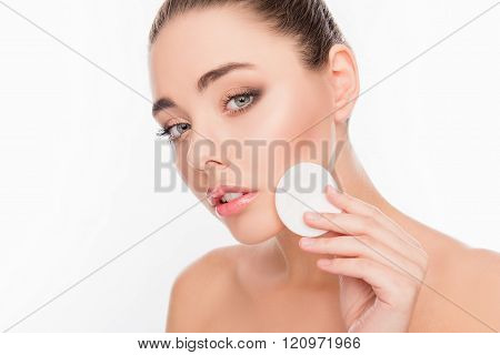 Close Up Portrait Of Cute Young Woman Washing Off Her Makeup
