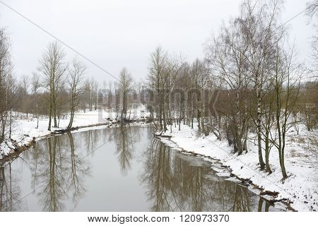 View of Slav River on the outskirts of St. Petersburg at cloud winter day Russia.
