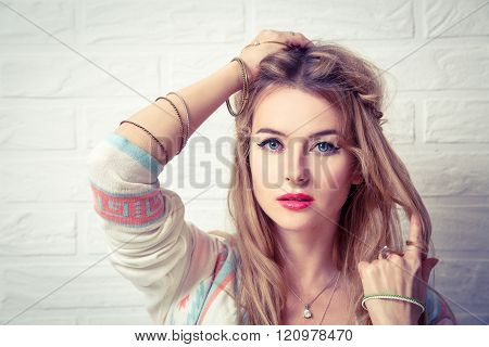 Boho Girl Portrait at White Brick Wall Background