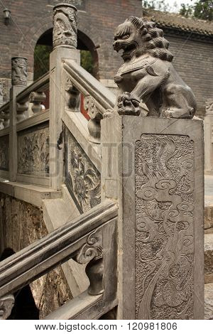 Stairs with carved stone lion statue in a temple