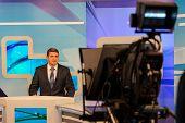 tv studio camera recording male reporter or anchorman. Live broadcasting poster
