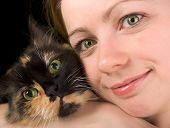 portrait of young beautiful green-eyed girl with cat poster