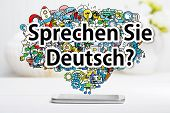 Sprechen Sie Deutsch (Do you speak German) message with smartphone on white table poster