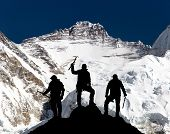 View of mount Lhotse from Pumo Ri base camp and silhouette of group of climbers with ice axe in hand Everest area Khumbu valley Sagarmatha national park Nepal poster