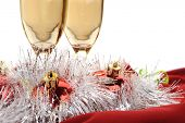 Extreme close-up image of Champagne flutes and Christmas setting poster