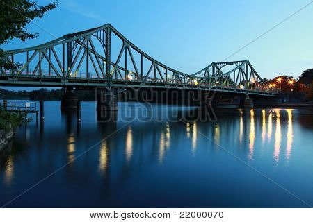 The Glienicker Bridge (German Glienicker Bruecke) goes over the Havel river and connects Potsdam with Berlin. It was part of the iron curtain. poster