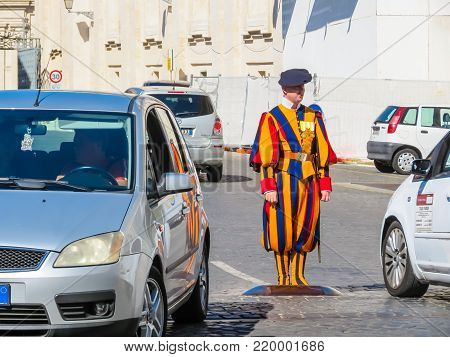 VATICAN CITY, VATICAN - AUGUST 31, 2013: Papal Swiss Guard standing at gate of Vatican