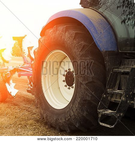 Blue Tractor.Horizontal view of tractors rear in sunny day