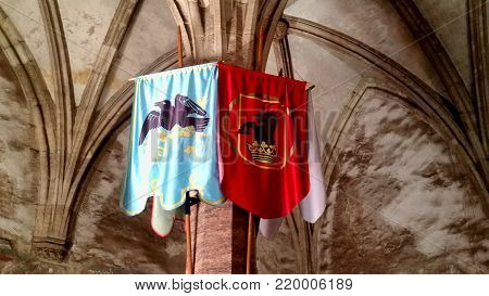 OLD FLAGS IN KNIGHTS ROOM IN HUNYADI CASTLE, HUNEDOARA, ROMANIA