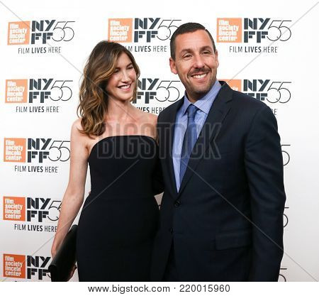 NEW YORK-OCT 1: Adam Sandler (R) and wife Jackie attend