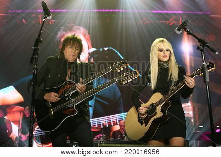 NEW YORK-NOV 29: Musician Richie Sambora (L) and Orianthi perform at America Salutes You and Wall Street Rocks Presents Guitar Legends For Heroes at Terminal 5 on November 29, 2017 in New York City.