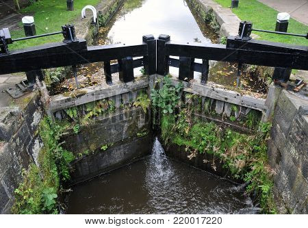 old wooden canal lock gates on the rochdale canal in hebden bridge