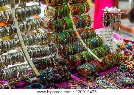 POKHARA, NEPAL - September 29, 2013: Jewelery on the stand. Original regional jewelery from Nepal. Pokhara streets.