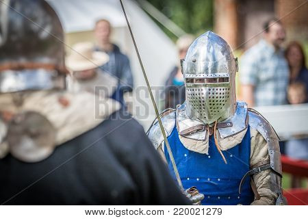 Medieval knight fighting another kight with a sword