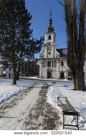Ancient city center of town Spisske Podhradie, Slovakia ( near with Spis castle ) , Europe at sunny winter day. The path leading to the ancient church. Popular tourist place.