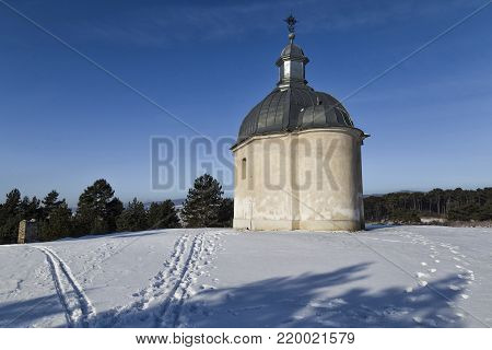 Saint Rozalia Chapel on the trail of Spis Jerusalem in snow. Ancient Spisska Kapitula l ( Spis Chapter house , known as the Slovak Vatican ) . Spisske Podhradie, Slovakia, UNESCO World Heritage Site.