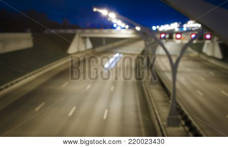 Night city view in blur. City street blurry photo. Street life bokeh image. Street view with  cars defocused image. Road in big city bokeh image. Night city lifestyle blurry background